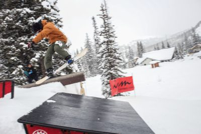 Second at Men's Open Snowboarding, Paxon Alexander with a stylish late backside 180 over the roof.