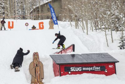 First place in Men's Open Snowboarding Bryan Watson with a stylish front nose press on the wave rail.