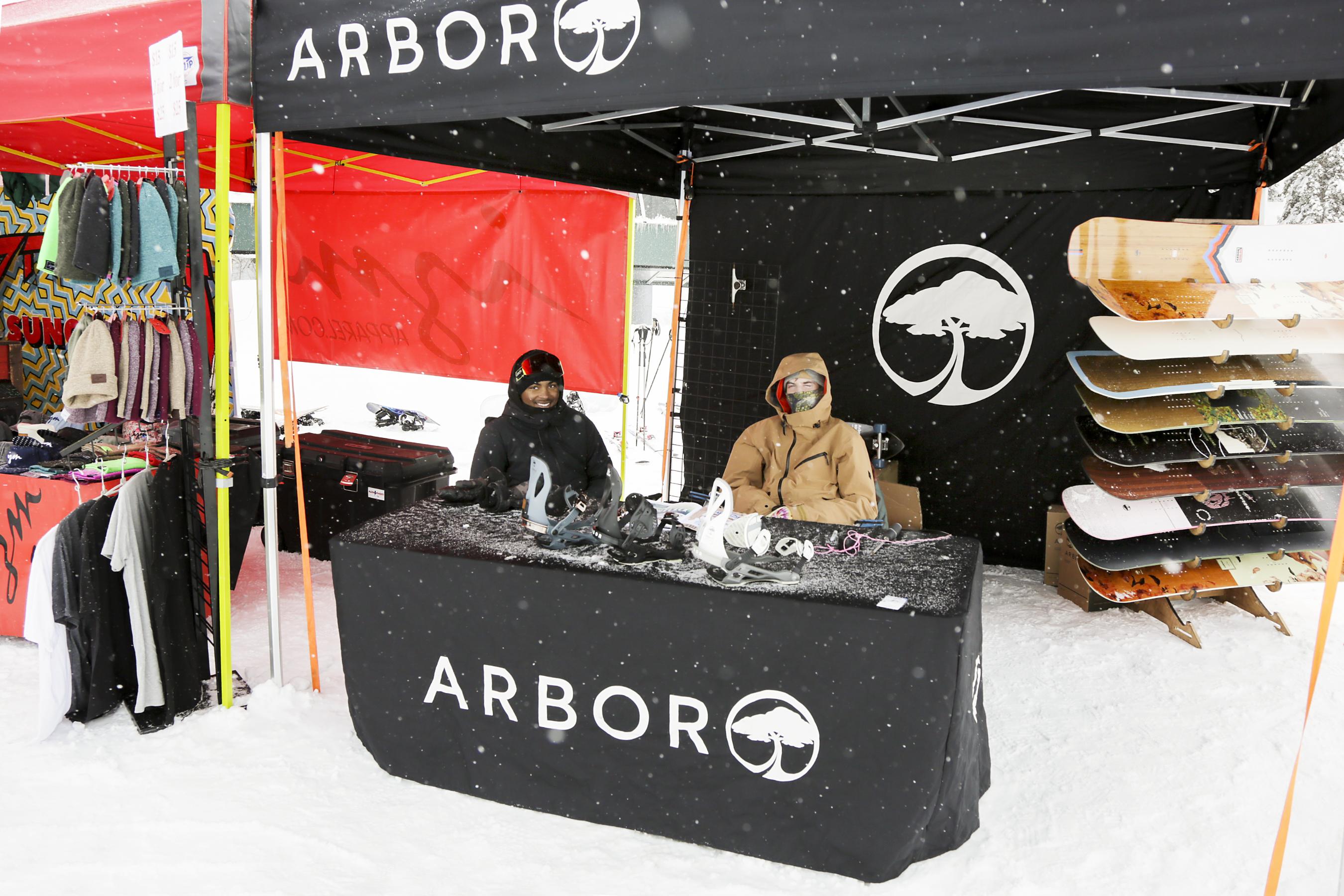 Jack Hessler and Jack Griffin of Arbor Snowboards staying warm.
