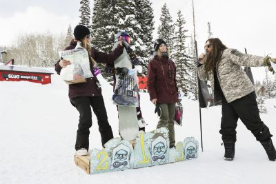 Winners of the woman's open snow show gratitude. 1st place Gwynnie Park, 2nd place Lexie Bryner, and 3rd place Jess Kelley.