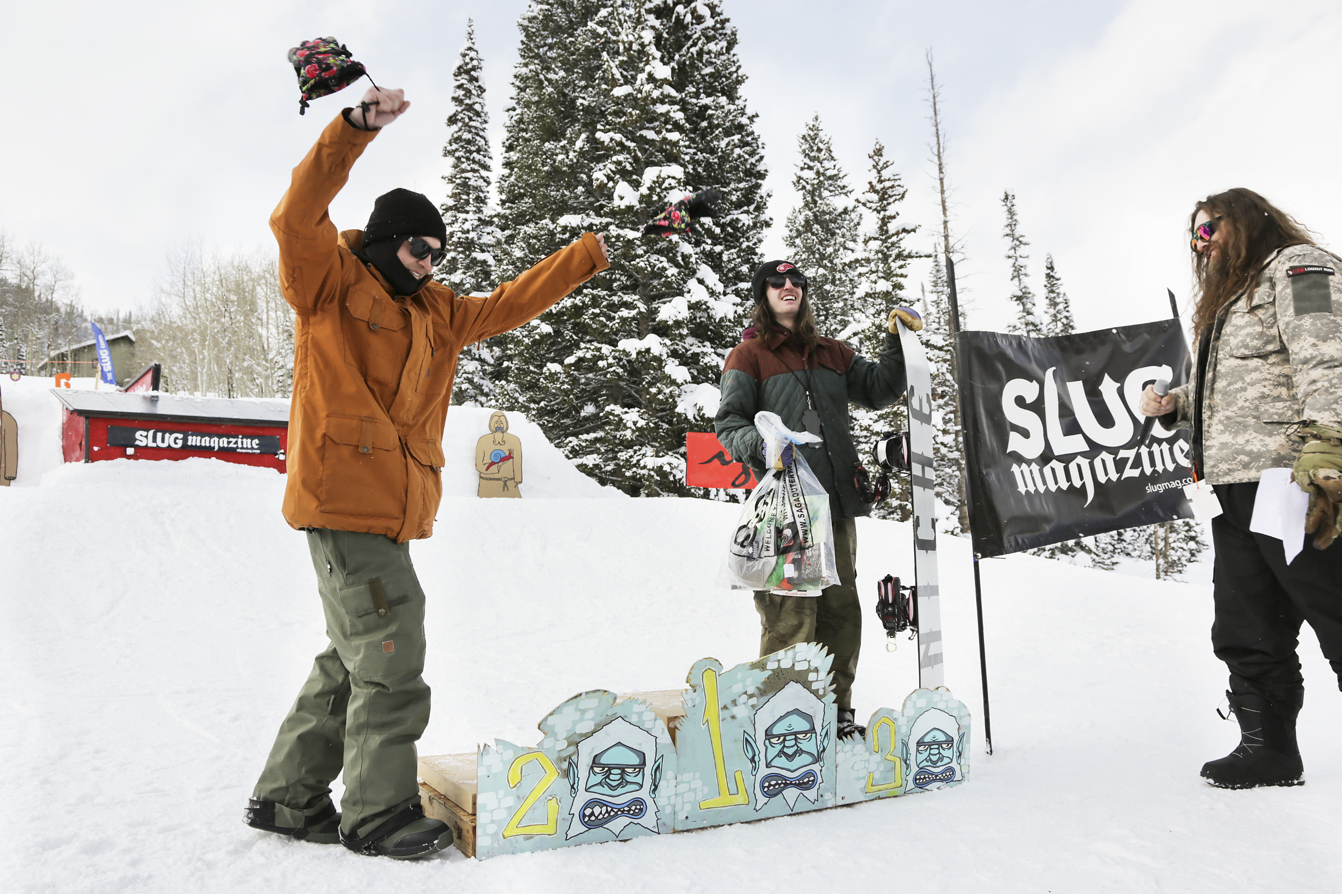 2nd place winner Paxon Alexander of the mens open snow proudly walks up to the podium to join 3rd place winner Evan Thomas.