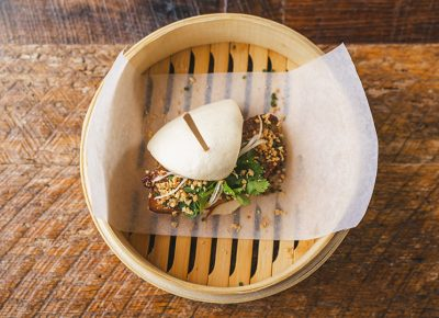 "The Pork Belly Bao puts the ""ooh"" in umami with its savory pork belly and add another unique elements to the happy hour menu"