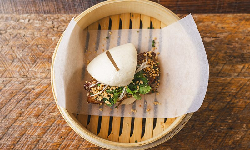 "The Pork Belly Bao puts the ""ooh"" in umami with its savory pork belly and adds another unique element to the happy hour menu. Photo: Talyn Sherer"