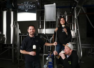 (L–R) Co-owner/brewer Kevin Templin, Brittany Watts and Jaron Anderson band together for the family feel of T.F. Brewing and its German-style lagers. Photo: LmSorenson.net
