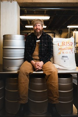 Chad Hopkins amongst his brewing gear. Photo: LmSorenson.net