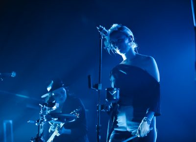 Back up vocal support for Hozier, playing in the blue backlight on the stage at the Union Event Center. Photo: @Lmsorenson