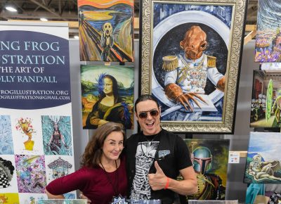 Artists Holly and Christopher posing in their pop-up shop in the Artist Alley. Photo: @Lmsorenson