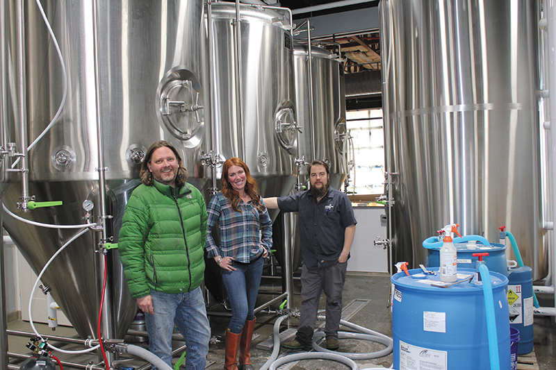 (L–R) Owner Mark Medura, Sales & Marketing Manager Katie Flanagan and Head Brewer Chris Detrick are kicking of Level Crossing Brewing Company in South Salt Lake with mostly classic ales.