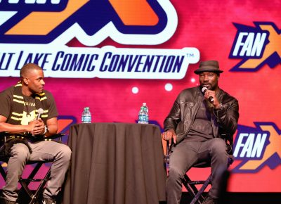 "Luke Cage himself, Mike Coulter on stage talking about his influence as a ""Black Captain America"" as put forward by host Jay Whittaker during his panel. Photo: @Lmsorenson"