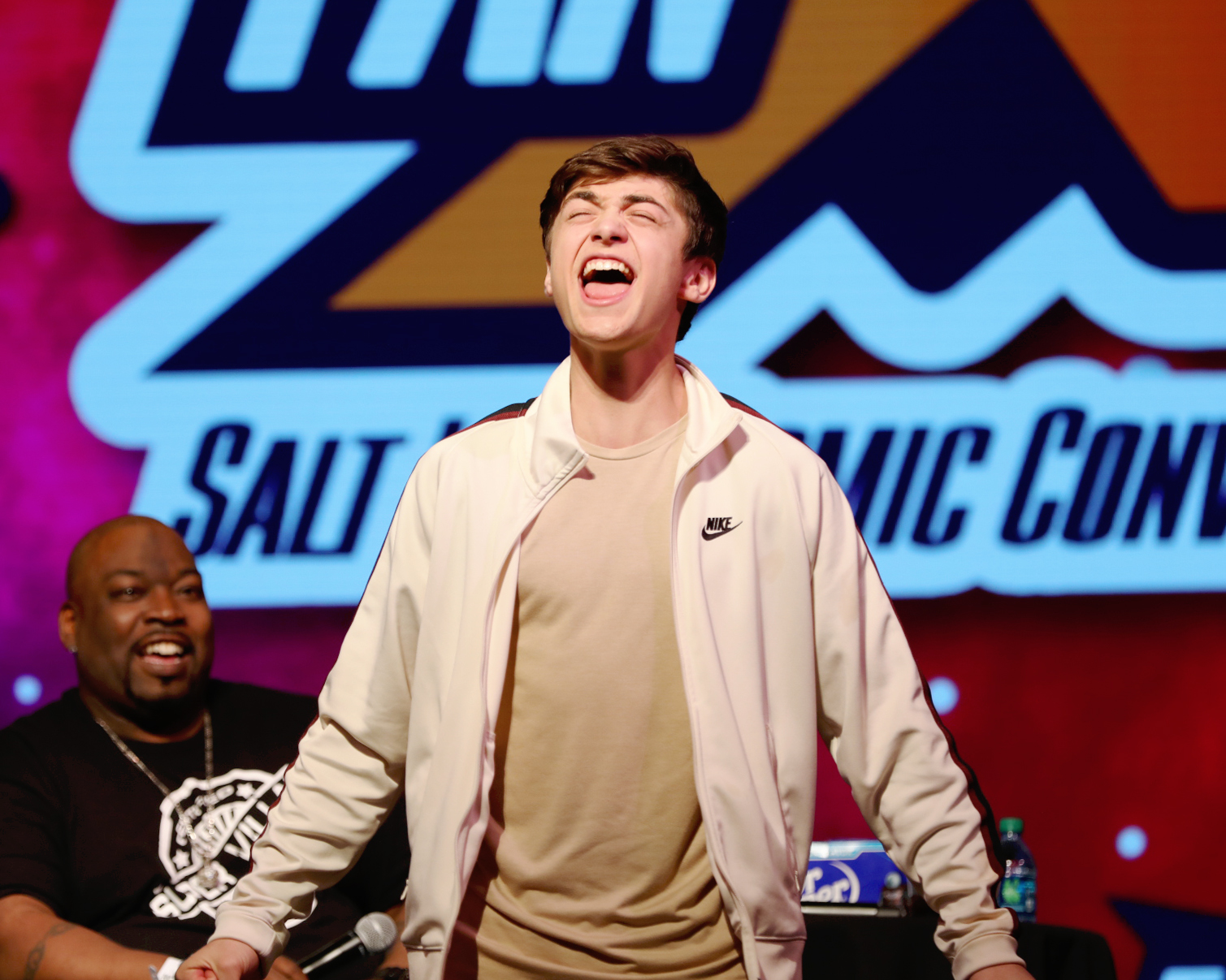 "Showing fans the classic line ""SHAZAM!"" Asher Angel on stage at Salt Lake Comic Convention FanX19. Photo: @Lmsorenson"