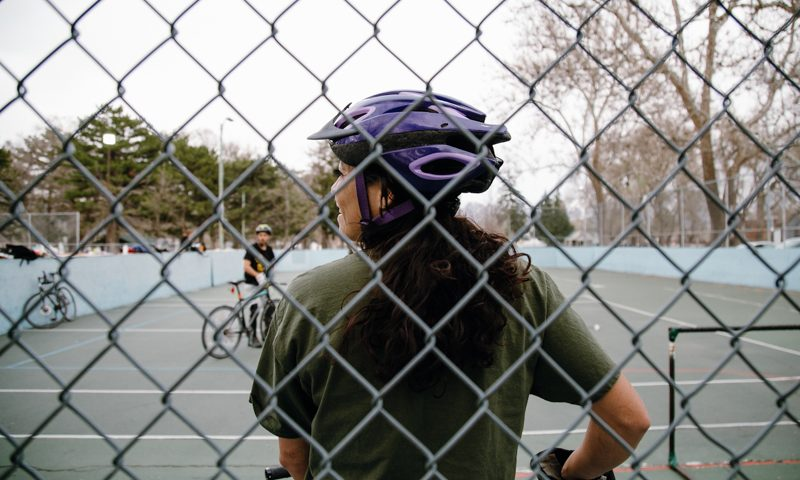 Beehive Bike Polo Club member observes the game at the club's city-sanctioned courts at Jordan Park. Photo: Matthew Hunter