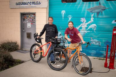 """(L–R) Saturday Cycles Owner Mark Kennedy and Director of Social Media Engagement Steve """"bykmor"""" Wasmund organize one-night overnight bike trips for busy SLC dwellers to get to the great outdoors quickly. Photo: John Barkiple"""