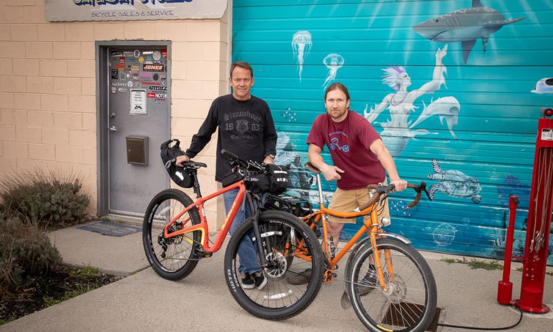 "(L–R) Saturday Cycles Owner Mark Kennedy and Director of Social Media Engagement Steve ""bykmor"" Wasmund organize one-night overnight bike trips for busy SLC dwellers to get to the great outdoors quickly. Photo: John Barkiple"