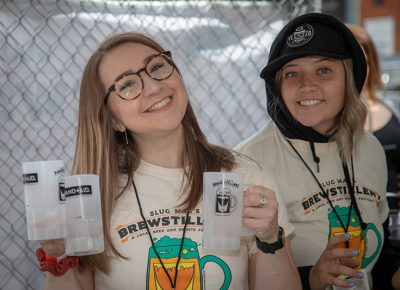 (L-R) Rosemary Roller and Abbie Robinson are first-year volunteers at Brewstillery. Volunteering at SLUG Magazine events is a great way to meet lots of locals and get behind Salt Lake's scene. Photo: John Barkiple