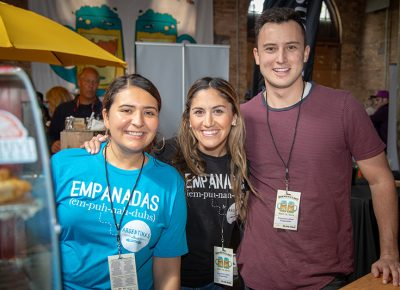 (L-R) Jenn Salazar, Ana Valdemoros and Keaton Hill work the Argentine's Best Empanada booth at Brewstillerty. Valdemoros, district 4's city council member, presented the award for best spirit— people's choice. Photo: John Barkiple