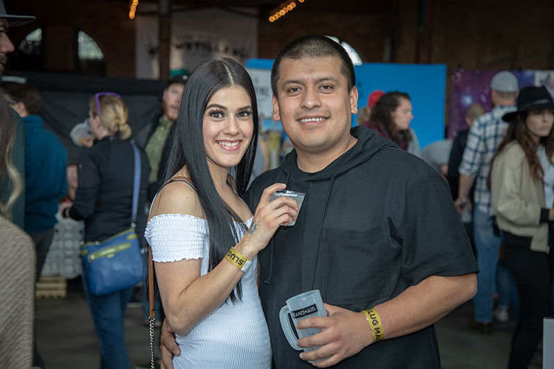 (L-R) Jenny and Edgar Maqueda took selfies all over the festival. She liked Alpine's gin, and he liked Zólupez's beer. Photo: John Barkiple