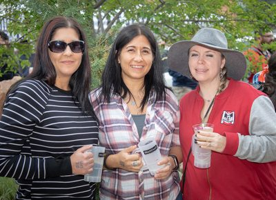 (L-R) Sarah and Starr Soliz and Bethanie Monsen-Ford abandoned John Ford, SLUG Mag's Community Development Manager, to sample a few beers and spirits. He's busy making Brewstillery happen, so he'll have to catch up later. Photo: John Barkiple