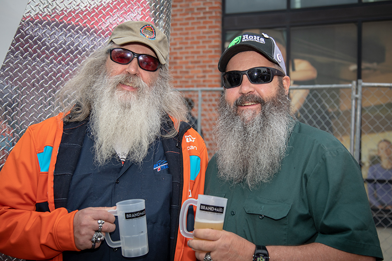 (L-R) Scott and David Ruster dropped tokens for Uinta Brewing Company's Test Phaze IPA. Photo: John Barkiple