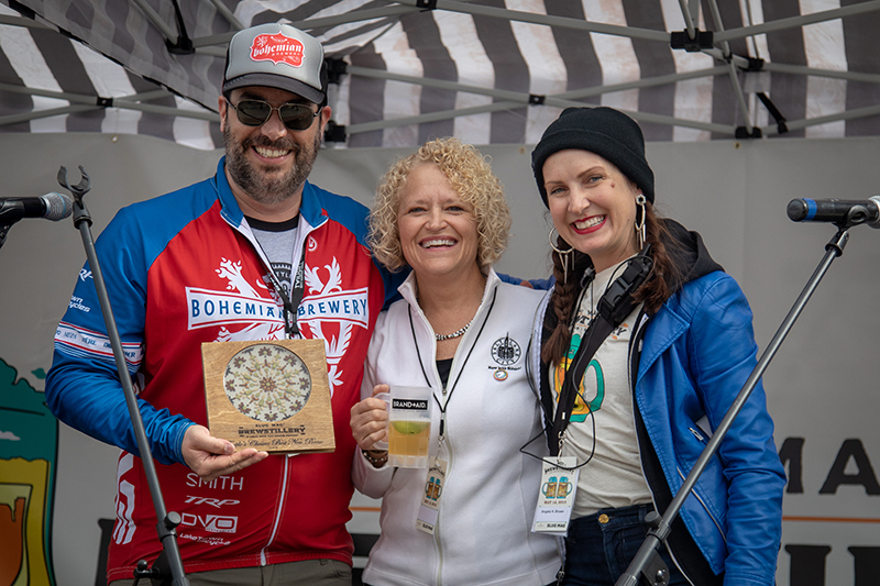 Salt Lake City Mayor Jackie Biskupski and Angela H. Brown awarding Kelly Schaefer of Bohemian Brewery with the Best New Brew and People's Choice: Best New Brew awards. Photo: John Barkiple