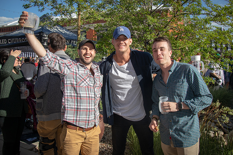 (L-R) Kelly Boyce, Ty Strong and Carson Ewell lucked out with a beautiful day after a cloudy start for Brewstillery. Boyce started drinking when the gates opened, and he's been here all day. He particularly liked the corn hole in the Game Area. Photo: John Barkiple