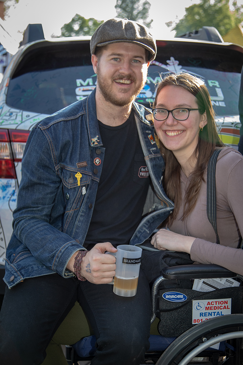 (L-R) Trevor Smith and Chelsea Harmon relax by Mark Miller Subaru's Art Car. Smith started with a High West Double Rye cocktail called a Spaghetti Western, but now he's sampling beer. Photo: John Barkiple