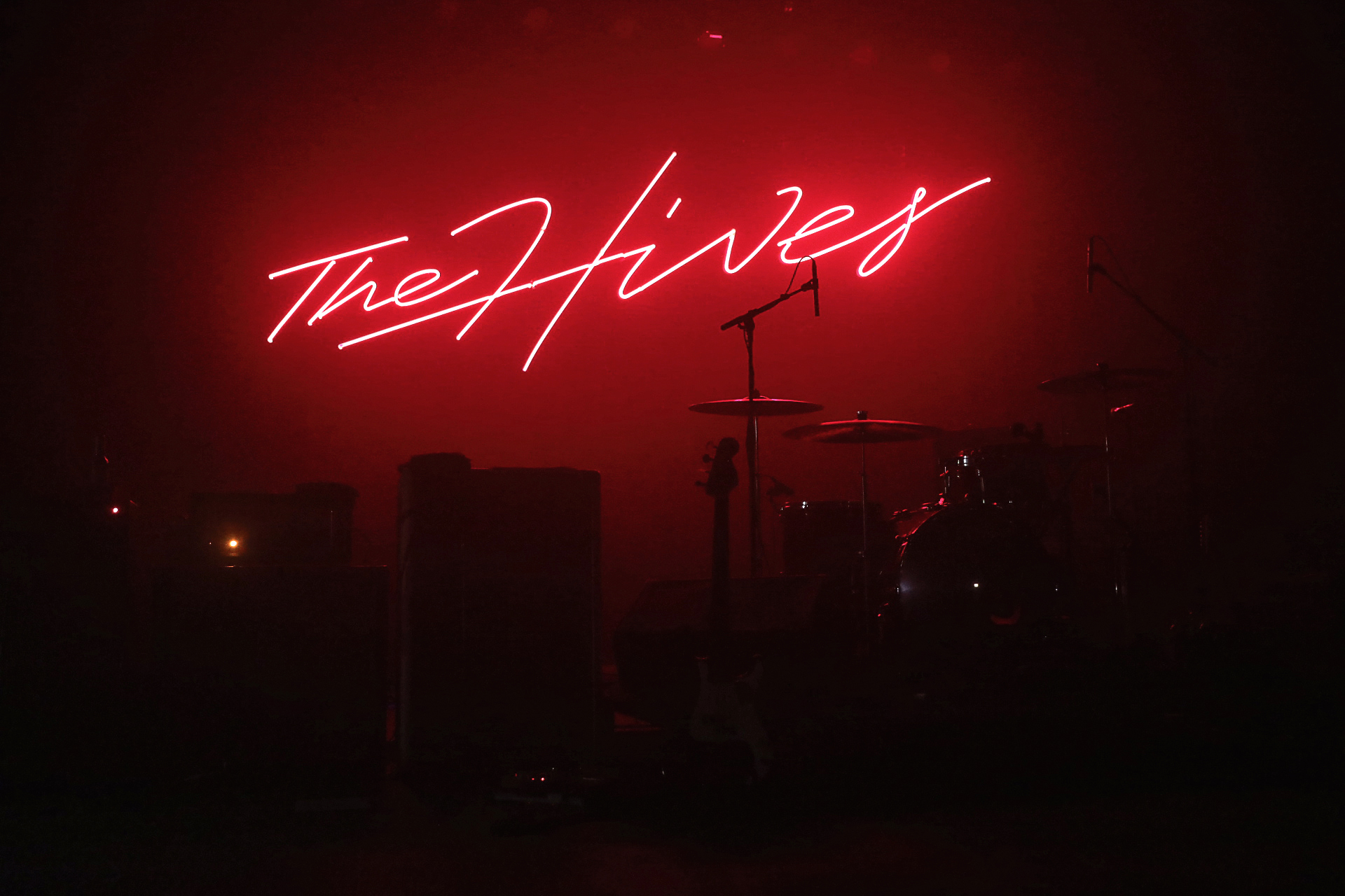The Hives signage glowing behind the stage before the music begins. Photo: @Lmsorenson