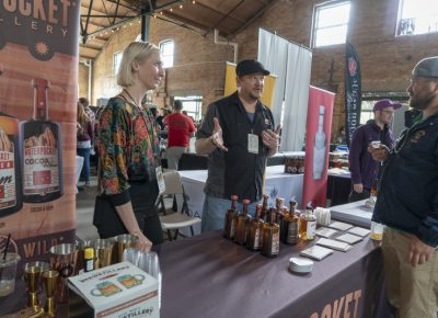 Waterpocket Distillery explaining their product to a participant. Photo: Jayson Ross