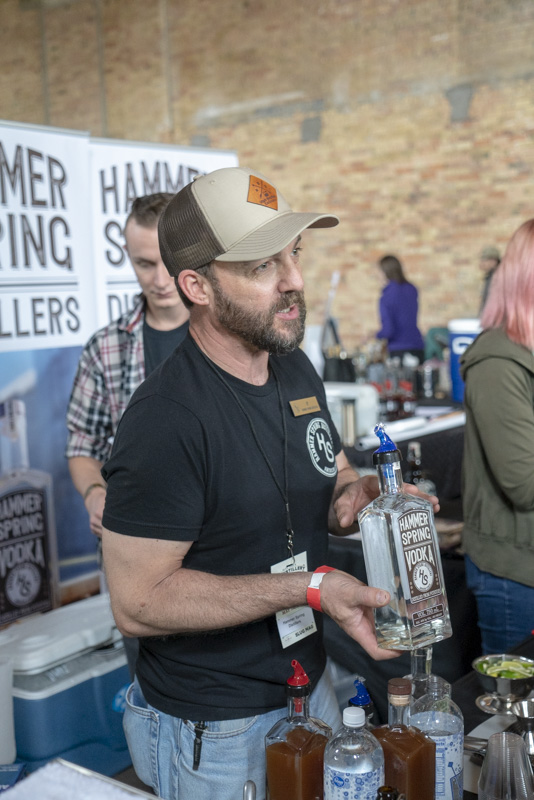 Hammer Spring Vodka showing off their vodka. Photo: Jayson Ross