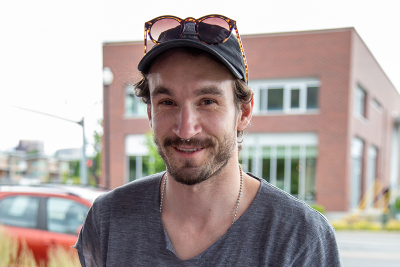 Matty Coles scored a gift bag for finishing dead fucking last. It's a dubious honor at SLUG Magazine's alley cat race. Photo: Kaylynn Gonazlez
