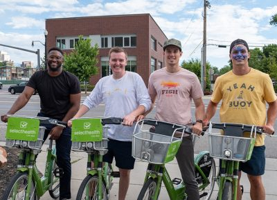 "(L–R) Akiode Udonton, Michael Moody, Luke Pyper and Matt Wood grabbed some SLC Green Bikes for the SLUG Cat. Wood wasn't too shy to ""rawr"" with that dino on his face. Photo: John Barkiple"