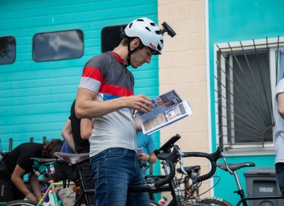 While waiting for the race to begin behind Saturday Cycles, Dallin Witt searches for clues in SLUG to build his manifest.This is his first alley cat—He didn't even bring his fast bike. His steel steed weighs more than 30 pounds, and he uses it mostly for travelling and tours. Photo: Kaylynn Gonazlez