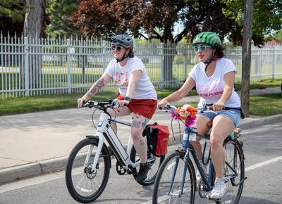 (L–R) Chrissy Upton and Jennifer Ortiz rode in the 2019 SLUG Cat with a group of friends that have been pals for 10 years. Ortiz decorated her bike for the Bike Prom ride from Fairmont Park to Liberty Park. She likes to ride long distances along the Jordan river or on the Legacy Parkway. Photo: Kaylynn Gonazlez