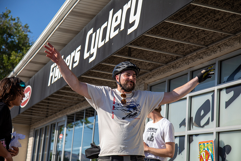 Christian Riley knocks out seven jumping jacks at Fishers Cyclery before earning a stamp on his manifest. Riley broke his chain right after this stop, but Fishers installed a fresh one to keep him in the race. Photo: Kaylynn Gonazlez