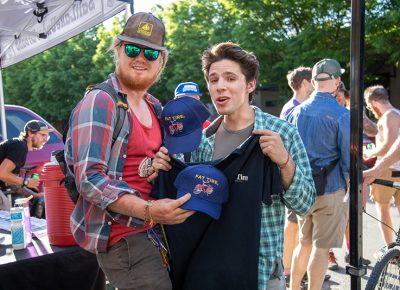 (L–R) Kent Boardman and Adrian Martin score some Fat Tire hats and shirts at SLUG Cat. Photo: Kaylynn Gonazlez