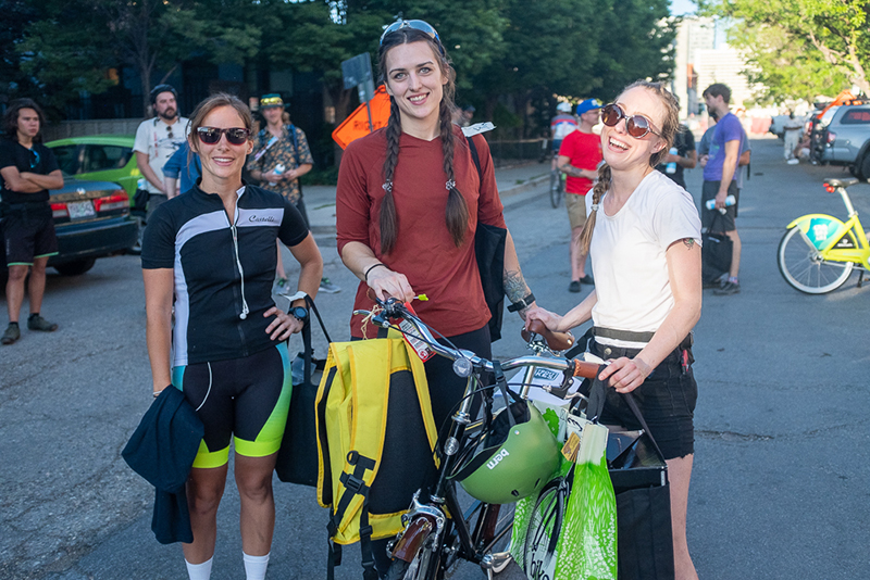 Second-place finisher Melissa Ilardo, third-place finisher Marian Lewis and first-place finisher Renée Draper gather around the Draper's prize bike. Photo: Kaylynn Gonazlez