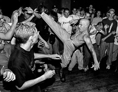 Hardcore punks and straightedge kids thrash in the pit to the band Ookla the Mok, performing at the Tower Theater in Salt Lake City on August 16, 1998.
