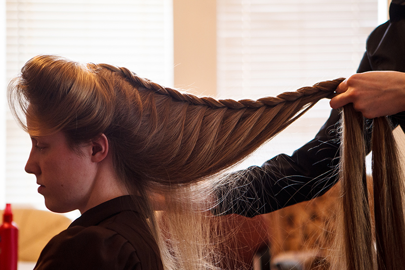 Helen Holm braids Allie Steed's hair in Colorado City, Arizona on December 1, 2012. The two young women had recently left the Fundamentalist Church of Latter-Day Saints.