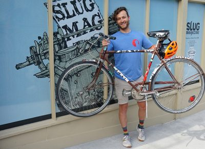 First-place winner Clint Campbell poses with his prize bike in front of the SLUG offices. Photo: Joshua Joye