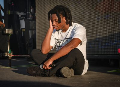 After putting all of his energy into his performance, Denzel Curry collapses in exhaustion. Photo: Colton Marsala