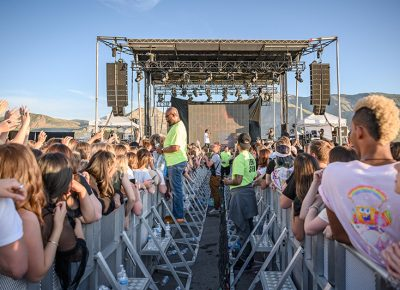 As Denzel Curry performs, the pathway to the stage separates one side of the crowd from the other. Photo: Colton Marsala