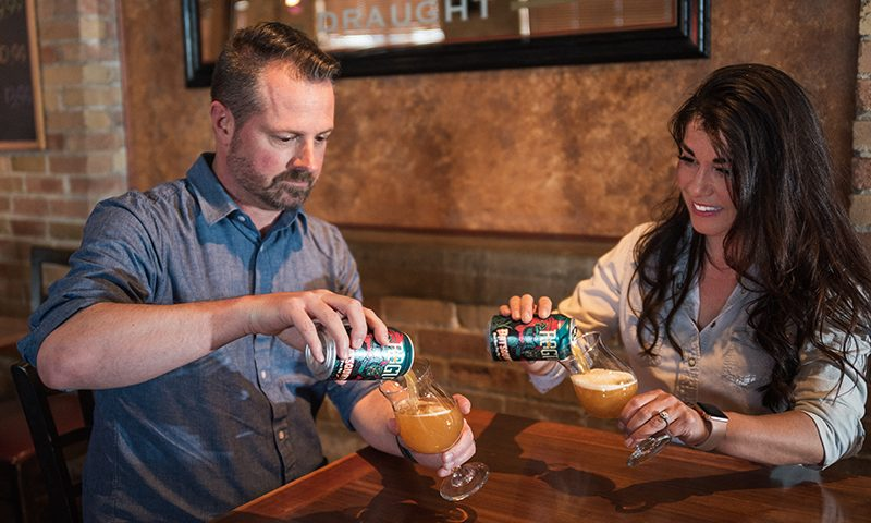 SLUG beer experts Chris and Sylvia Hollands testing the Batsquatch pour.