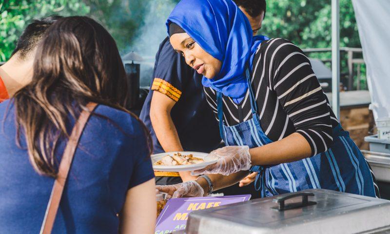 Fouzia Abdirahaman of Kafe Mamai serves up some fresh cooked jerk chicken. Photo: Talyn Sherer