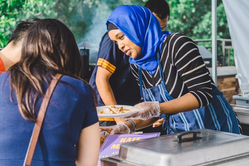 Fouzia Abdirahaman of Kafe Mamai serves up some fresh cooked jerk chicken. Photo: Talyn Sherer