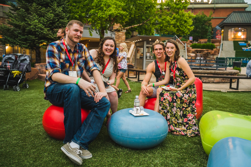 (L–R) Javin Hull, Alli Milne, Jarom West (designer for Salt Lake Magazine) and Madaline Slacktake a break from the festivities to enjoy the relaxing lounge seats on the lawn.