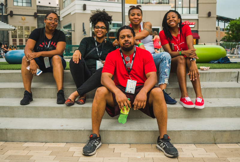 (L–R) Lena Jones, Leah Richardson, Corey Jones, Lakisa Ellis and Angelica Briggschill rest out on the steps before heading back into Tastemakers for a second round of snacks.