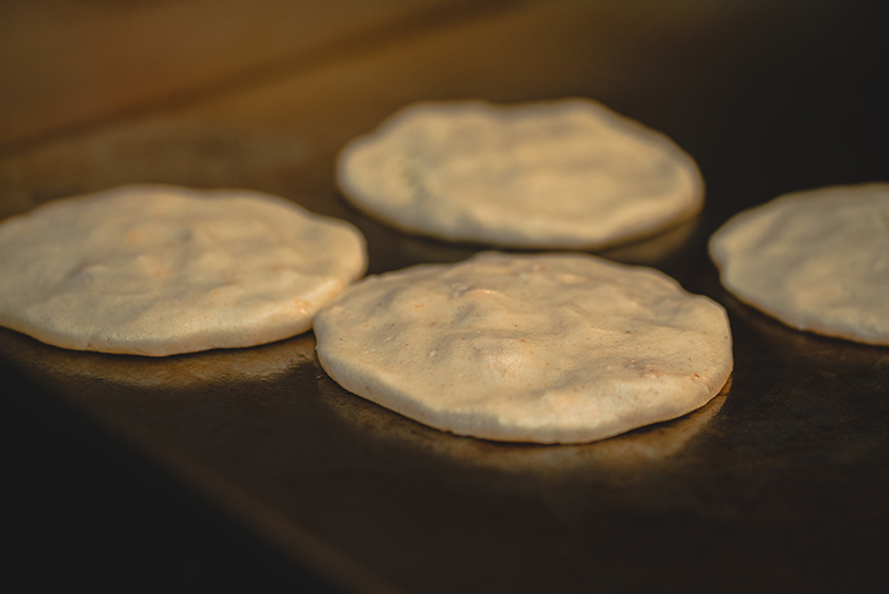 The beginning of the delicate pupusa process.
