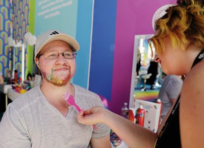 Glitter makeover! Attendees get their pride on and get all gussied up at Loveloud.