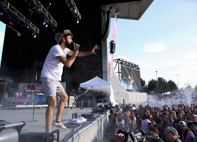 AJR playing on stage at Loveloud.