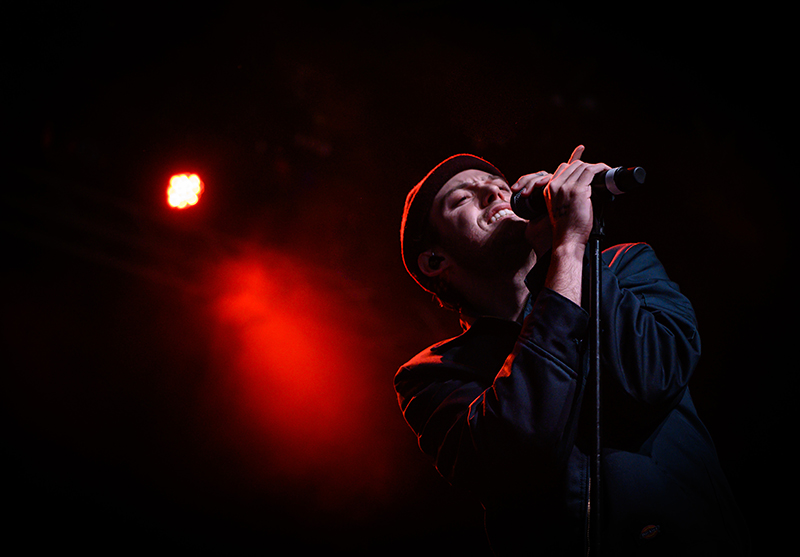 Bathed in red light, Harry Hudson soulfully croons to the crowd at the Complex.