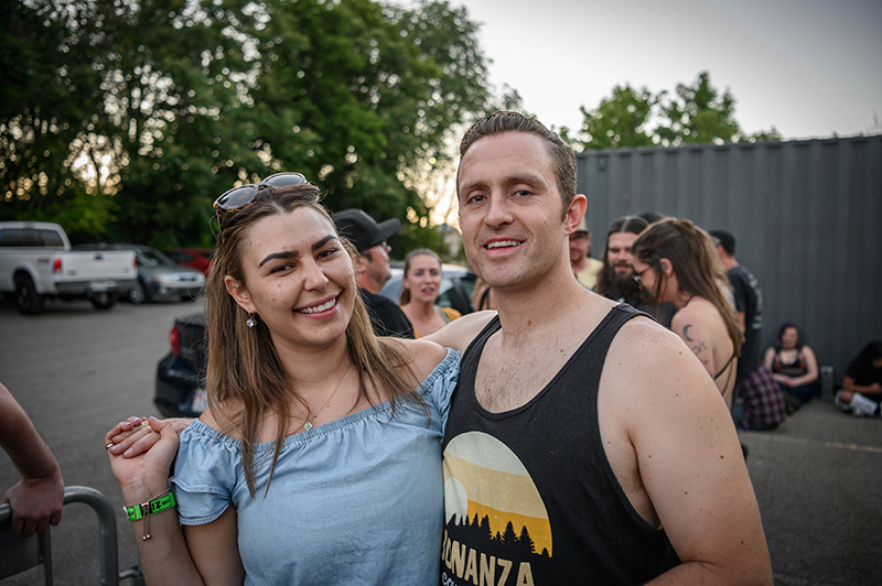 Smiles shine through as fans enjoy the cool evening weather during their queue up.